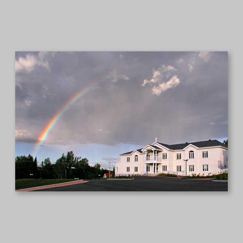 postcard - the residence under a colourful rainbow